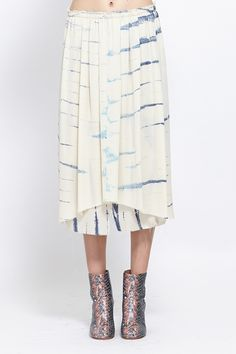 double layered gathered skirt in a soft printed silk fabric. Raw edges at waist and hem. Elastic waist. Slightly longer at back. Slips on.