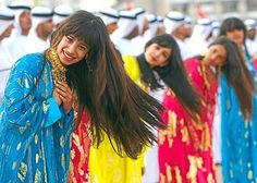 "الكورار - Google Search Emirati girls in their ""Emirati"" style thobes, taking part in the Ayyala traditional dance of the UAE."