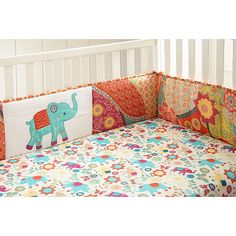 The Zahara Crib Bumper is a four piece bumper with a colorful and eclectic print on the front and back and elephant applique in the center. Coordinates with the Zahara Nursery Bedding Collection.