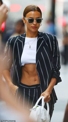 Irina Shayk flaunts her toned abs in a crop top and pinstripe suit Celebrity Style Casual, Celebrity Style Inspiration, Celebrity Outfits, Mode Inspiration, Fashion Week, New York Fashion, Fashion Models, Modell Street-style, Mode Outfits