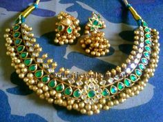 Jewellery Designs: Floral Tussi Choker with Emeralds