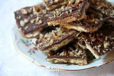 Chocolate Toffee Bark / Saltine Cracker Candy - Saltine crackers, spread with a boiled brown sugar and butter sauce, then topped with chocolate and nuts, sometimes called Fools Toffee, Christmas Crack or Crack because they are downright addictive.