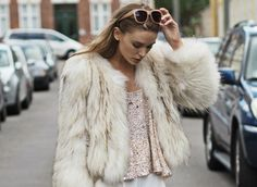 Danish Bloggers to Follow For Copenhagen Fashion Week - Danish reality star winner, Tina Maria Hansen wearing a fur coat + pink sequined top and nude sunnies