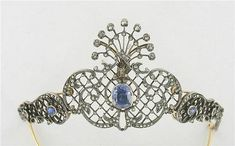 Sapphire and diamond tiara, c1880, decorated with scrolls and trellis set with small brilliant-cut and rose-cut diamonds. The center with a faceted oval sapphire can be worn as a brooch. Two small oval faceted sapphires on each side. Frame gold and silver.