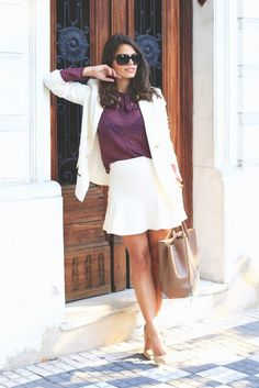 Style a blazer and skirt in the same hue but contrasting textures. It will keep your corporate style from looking too matchy-matchy. Layer the set with a silk button-down that you will want to flaunt when you ditch the jacket after-hours.