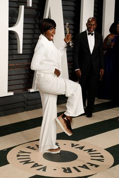 Viola Davis's Oscar afterparty sneaker swap into a pair of metallic copper creepers and a white pantsuit is the definition of chic casual style.