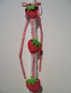 Greek Easter candle (lambada) for kids decorated with  fabric strawberries and ribbons with tine rhinestones.