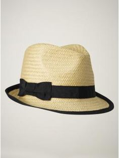LOVE this classic fedora with a twist (the bow), I've got a fedora with 3 interchangeable bands that I'm in love with!
