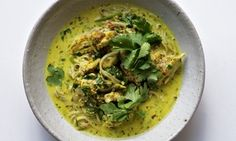 Nigel Slater's quick chicken laksa recipe. Into a food processor put two small hot red chillies, two roughly chopped inner stalks of lemongrass, two cloves of garlic, the juice of a lime, a handful each of coriander leaves and mint, three teaspoons of turmeric and three tablespoons of groundnut oil. Process to a rough paste...
