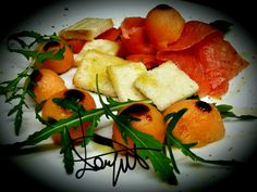 Marinated Salmon with cantalupe melon, rocket, butter croutons and balsamic vinegar. .