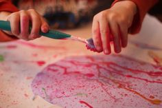 Egg Splatter Painting for Easter - Splatter paint some eggs for Easter using toothbrushes!