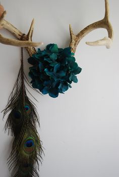 Deer Antler Jewelry Rack with Flowers & Peacock Feathers, $130.00, via Etsy.
