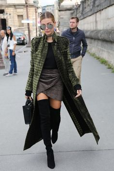 Hailey Baldwin in a Velvet Coat with black thigh high OTK boots.