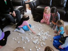 """love how she organized the gift-opening (maybe we'll actually do that this year?) and played """"scoop the snowballs"""""""
