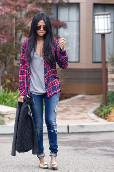 A plaid flannel shirt is the epitome of casual style. Wear it open over a tissue-thin T-shirt as Sheryl of Walk in Wonderland does. Perfectly worn in and slightly loose, the outift gives a look that recalls the days of '90s grunge. Pair a baggy flannel shirt with distressed skinny jeans and loafers for a modern approach.