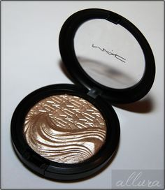 MAC Extra Dimension Highlighter in Whisper of Gilt: light soft white gold with shimmery sheen - great cheek highlight
