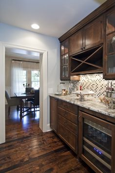 Dark Cabinets in Butler's Pantry with gorgeous, dark, rustic floors - by Schrader & Companies via Houzz