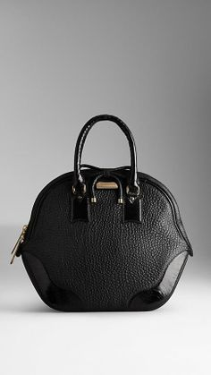 Burberry: the ultimate handbag - sleek, chic, and the perfect size. We'll be taking this one with us everywhere!
