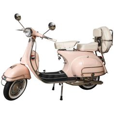 Fully Restored 1963 Pink with White Leather Vintage Italian Piaggio Vespa | From a unique collection of antique and modern more antique and vintage finds at https://www.1stdibs.com/furniture/more-furniture-collectibles/more-antique-vintage-finds/