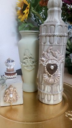 Altered Bottles using Chalk Paint ™ and IOD Decor Moulds.