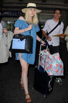 Dakota Fanning looks lovely in denim as she arrives at Nice airport for Cannes Film Festival.