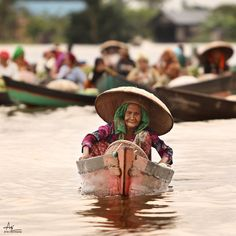 "Keep smile..old woman smile on her ""Jukung"" (boat) at Traditional Floating Market, Lokbaintan, South of Kalimantan, Indonesia..     B {} P"