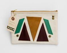 Love this gift for Maur!   Image of large zipper pouch with geometric leather appliques and a metal zipper (b)