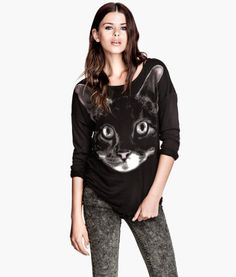 I've taken it upon myself to own all cat related clothing in the world.
