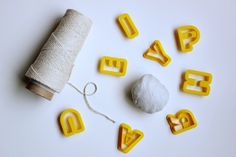 DIY Clay Letter Garland - what about christmasy ones? nice!