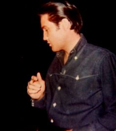 Elvis in april 13 1968 at his L-A house. He was working on his movie ( Live a little love a little ) at the time.