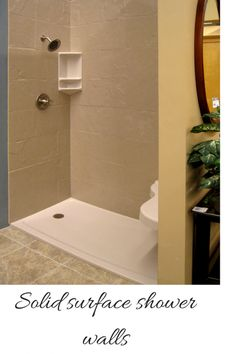 Solid surface shower walls can create a low maintenance and easy to install shower  system. This project used a stone-looking pattern and a low threshold base for easy entry.  http://blog.innovatebuildingsolutions.com/2014/08/31/compare-grout-free-shower-tub-wall-panels   #InnovateBuilding