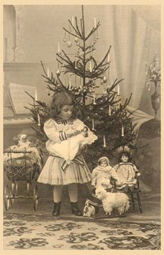 +~+~ Antique Photograph ~+~+    Sweet girl surrounded by dolls and toys under the Christmas tree.