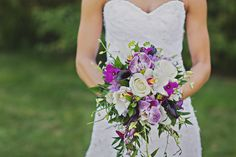 //Saskatoon Wedding Flowers// A cascade bouquet made with a lovely mix of phalaenopsis, cymbidium, and dendrobium orchids. Paired with calla minis, roses and mixed greenery. Photo by Danielle Stasiuk Photography Cascading Wedding Bouquets, Cascade Bouquet, Wedding Flowers, Dendrobium Orchids, Local Florist, Flower Boxes, Flower Delivery, Engagement Photography, Valentine Gifts
