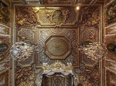 Looking up at the ceiling of Marie Antoinette's bedroom at the Palace of Versailles. Source