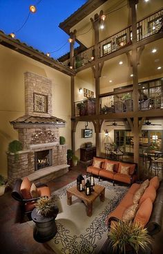 Tuscan style outdoor living space with three patios and a spacious and open plan. Very impressive porch! Maybe incorporate some of these elements on my patio! Outdoor Rooms, Outdoor Living, Indoor Outdoor, Outdoor Seating, Outdoor Patios, Outdoor Kitchens, Outdoor Decor, String Lights Outdoor, Mediterranean Homes
