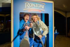 An oversize Ronzoni pasta box was a popular photo set, encouraging guests at the Al Fresco Feast to pose with large utensils.  Photo: Elizabeth Renfrow for BizBash