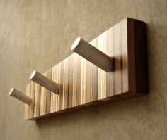 Unique wall coat rack in modern wood and metal.    Every coat rack will bear its own pattern or signature of radiant wood stripes.    We take