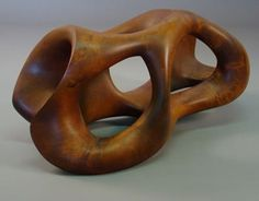 .jpg from  http://www.askart.com/askart/artist.aspx?artist=11161893  wood sculpture by -  E. Newell Weber (Effective shape design) This wooden sculpture has great organic shape