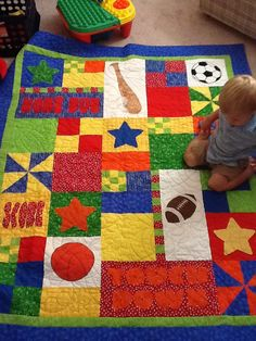 Sport quilt - for Grandbaby #7 -brother modeling