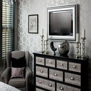 Framed TV, wall paper, chair, hint of chandelier, and the dresser. Fab!