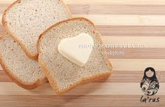Bread and heart shaped butter Buy this photo: http://www.istockphoto.com/stock-photo-22820899-bread-and-heart-shaped-butter.php?st=ff01df0
