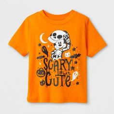 """Boo! Don't worry, there's nothing scary here — just the adorable Mickey Mouse Short-Sleeve Halloween T-Shirt from Disney®. This short-sleeve tee features a cotton-blend construction to keep your little guy nice and cozy on both warm summer evenings and cool fall days. The orange T-shirt is pictured with Mickey Mouse on the front all dressed up in a """"scary but cute"""" costume to get him excited for all the Halloween festivities. Have him wear it with shorts t..."""