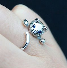 This Silver Plated Adjustable Cat Ring With Blue Zirconia Eyes