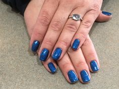 Cosmic blue biosculpture nails using the evo gloss top coat! Leaves the nails with a diamond shine for 3-4 weeks #evo #nails #biosculpture #nailidea #diamondshine #evotopcoat #amiciskelowna #nailskelowna