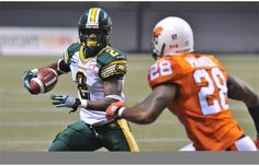 Byron Parker, 28, of the B.C. Lions tracks down Fred Stamps, 2, of the Edmonton Eskimos.