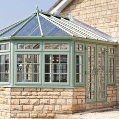 A REHAU uPVC Conservatory, showing that an array of coloured windows can be chosen, such as this Chartwell Green #REHAU #Colour #uPVC