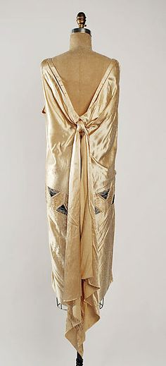 Evening dress 1928 attributed to Madeleine Vionnet (French, Chilleurs-aux-Bois 1876-1975 Paris) Silk, metal, glass (hva)