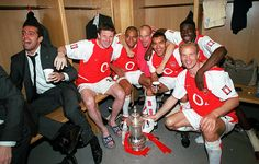 Edu, Oleg Luzhny, Gilberto, Freddie Ljungberg, Giovanni van Bronckhorst, Kolo Toure and Dennis Bergkamp with the F.A.Cup. Arsenal 1:0 Southampton. The FA Cup Final, The Millennium Stadium, Cardiff, May 2003