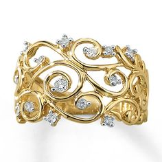 Vines of 10K yellow gold envelop round diamond blossoms in this graceful ring for her. This fine jewelry diamond ring has a total diamond weight of 1/4 carat. Diamond Total Carat Weight may range from .23 - .28 carats.