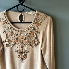 """Oscar de la renta cashmere sweater Taupe bead embellished cashmere 3/4"""" sleeve sweater by Oscar de la renta. Authentic. All beads are intact in perfect condition. Teeny tiny small hole at the bottom of the front .. Barely noticeable but worth mentioning. Is a L but fits closer to a medium Oscar de la Renta Sweaters Crew & Scoop Necks"""